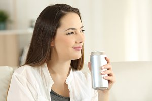 relaxed woman holding a soda can