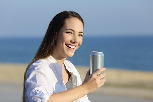 Woman holding a refreshment can