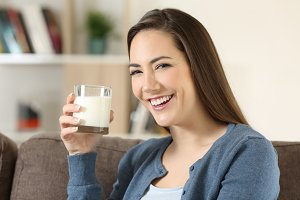 happy woman holding a glass of milk