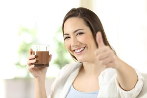 woman holding a cocoa drink