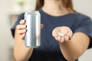 woman hands holding a soda drink