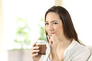 Woman drinking cocoa shake