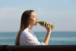 woman drinking a vegetable juice