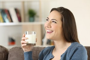 woman dreaming holding a milk glass