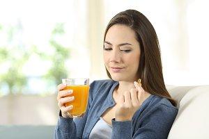 Woman doubting between juice & pills