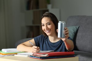 student showing an energy drink