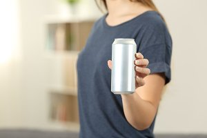 woman hand holding a soda drink can