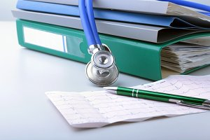 books folder file, stethoscope and RX prescription isolated on white background.