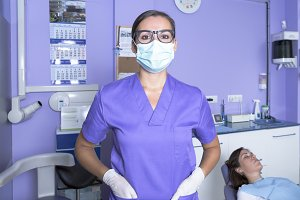 dental assistant with a mask