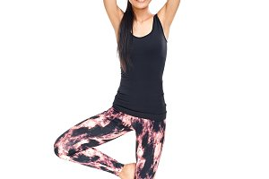 Asian woman standing in yoga pose