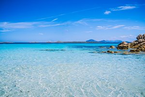 Clear amazing azure coloured sea water with granite rocks in Capriccioli beach, Sardinia, Italy