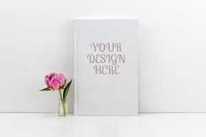 White book mockup with a pink peony