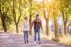 Couple in love  in autumn nature on a walk