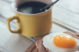 Breakfast. Coffee and egg on bread