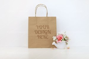 Mockup with flowers, craft paper bag