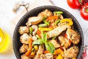 Chicken fried with vegetables.