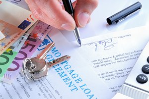 Client signing a mortgage loan rear