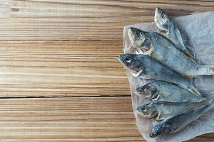 dried fish on a wooden table with co