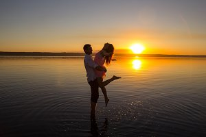 Young couple is dancing on beach