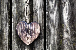 Wooden vintage heart on wood planks
