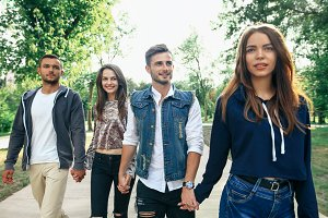 friends walking in park