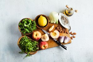fresh ripe ingredients on a cutting wooden board on the table fo