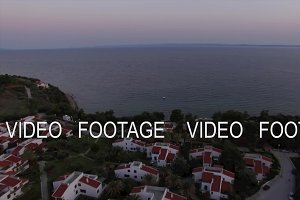Aerial scene of sea and cottages on the shore. Trikorfo Beach, Greece