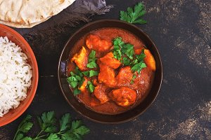 Chicken tikka masala with rice. Asian-Indian dish. Top view, copy space.