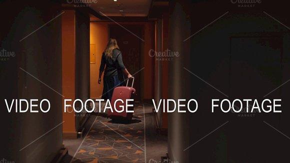 Woman Settling In Hotel Room