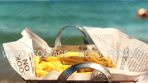 Eating Tasty Crunchy French Fries At The Beach