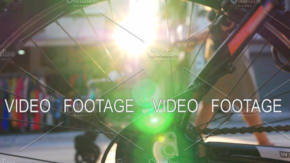 View Through Bike Wheel To Street And Sun Flare