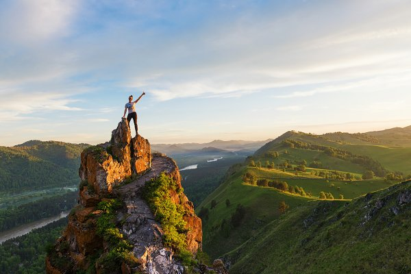 People Stock Photos: Jan Jack Russo Media - Woman on top mountain in Altai