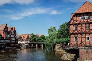 Half-timbered red bricks houses near the river at the old harbor of Luneburg, Germany