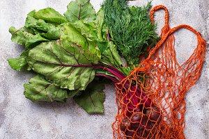 Fresh vegetable in fishnet bag