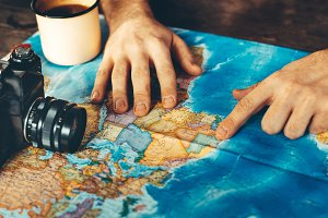 Traveler Man Planning Trip With Map