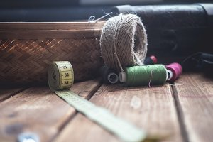 vintage knitting supplies on a wooden table