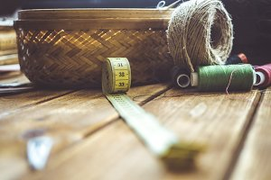 knitting rolls and centimeter on a table