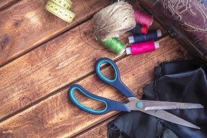 top down knitting supplies scissors and threads with cloth
