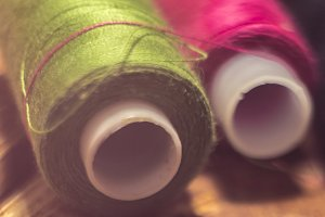 close macro shot of rools of  colour threads