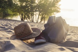 summer travel holidays, hat and bag on the tropical beach