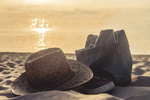 summer holidays leisure concept on a sunset, bag shoe and hat