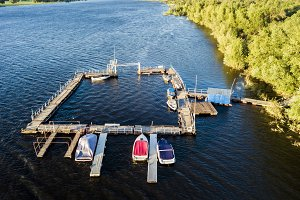 aerial shot of the shipping dock and motor boat pier in the river