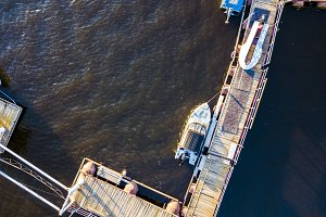 aerial shot of the luxury motor boat near the pier in the sea