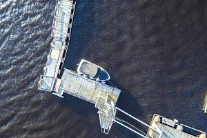 aerial travel motor boat near the pier in the sea