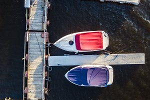 top down motor boats in the shipping dock in the sea