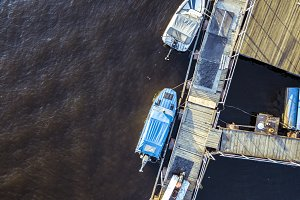 aerial top down view of two motor boats on the sea coast