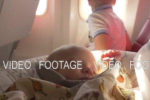 Baby girl sleeping in plane after breastfeeding