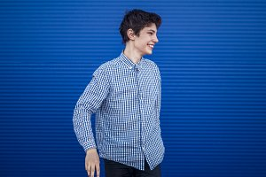 isslated smiling young man in casual clothes on a blue background