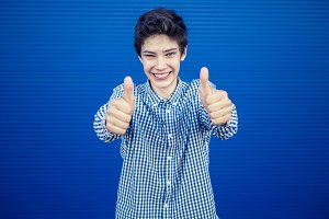 isolated smiling happy attractive person showing thumbs up