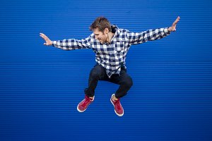 young man flying motion isolated, success concept